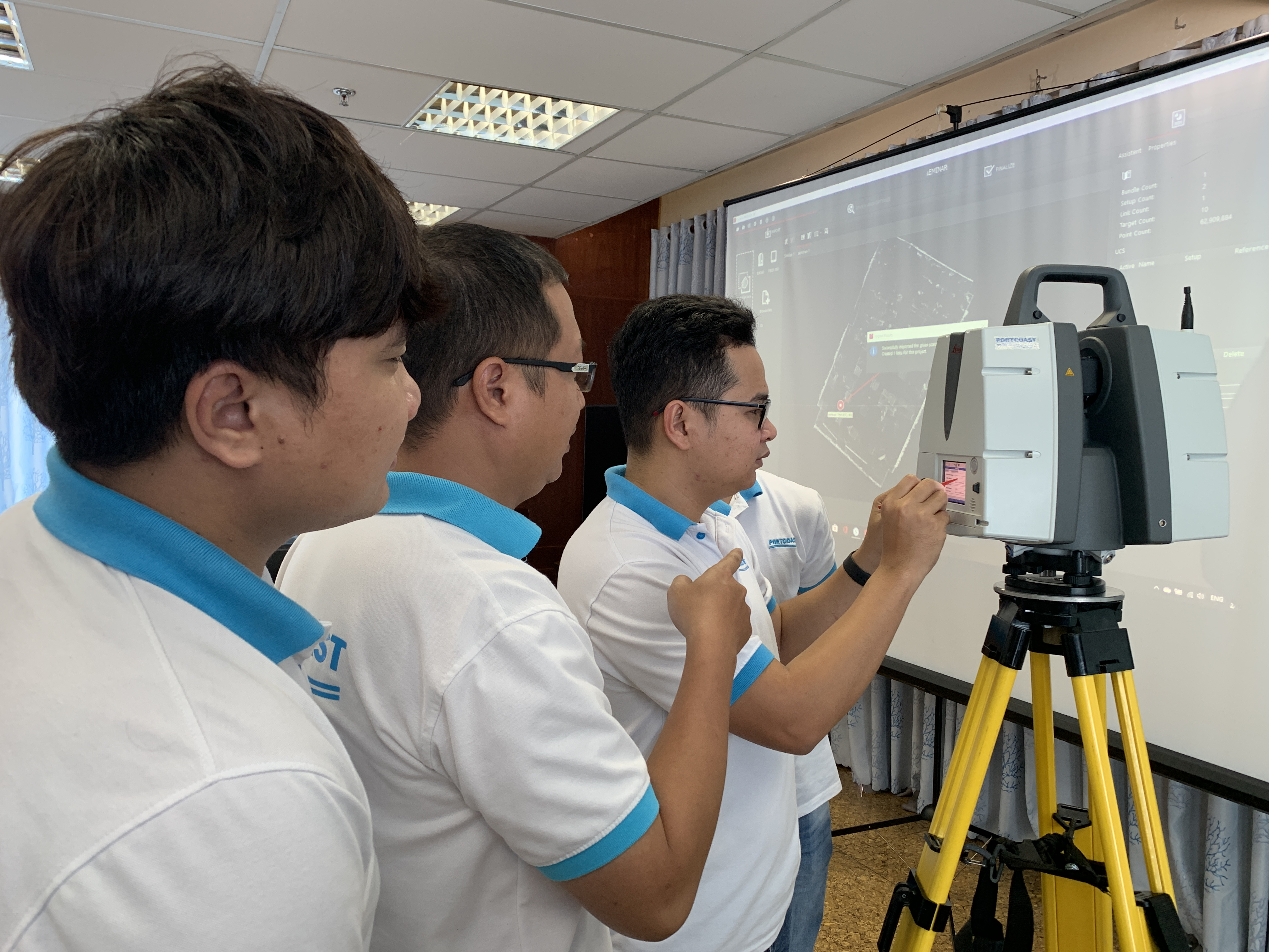 Employees and engineers work with the Leica Scanstation P50